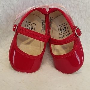 Red patent leather Mary Jane's